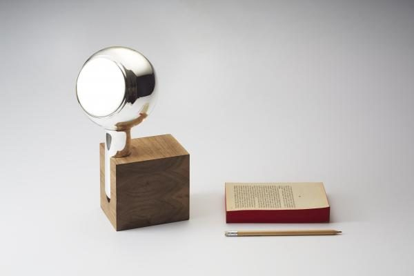 YVE hand mirror in a walnut block or oak shelf