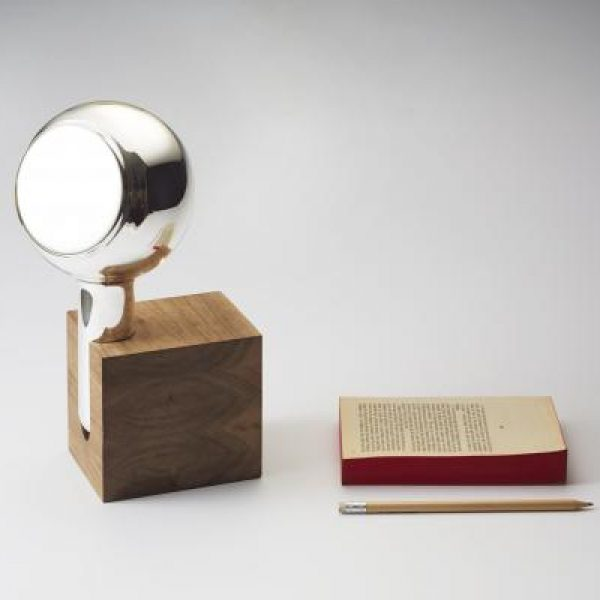YVE hand mirror in a walnut block or oak shelf